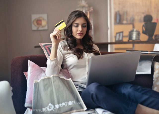 Credit Card Fees to Watch Out For - woman using her credit card online