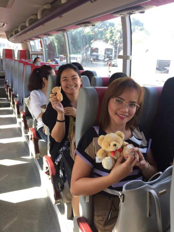 girls riding a P2P bus