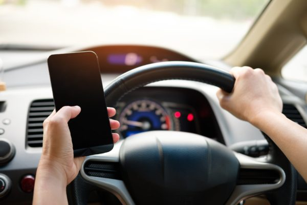 8 Possible Reasons Your Car Insurance Claim Got Denied - texting while driving